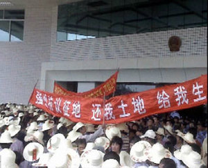 Residents of Nanwan village in southern Guangdong province protest outside a government building against alleged corruption surrounding a farm built on their land.