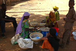 Woman selling milk and millet mixture in Zinder, Niger.