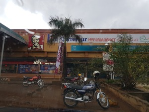 A shopping mall in Kampala, 2018. Multinational supermarkets tend to open in shopping malls in Africa alongside multinational fast food restaurants like KFC.