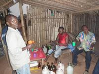Villagers relaxing with a few bottles of palm wine at the end of the day in the fields. (Photo: CEPECO-Congo)