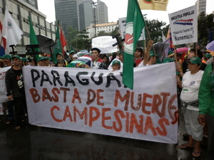 Peasant organisations affiliated with La Via Campesina Paraguay march at the People's Summit at Rio+20 in June 2012. They were protesting the killing of 11 peasants at Curuguaty a few days earlier. (Photo: GRAIN)