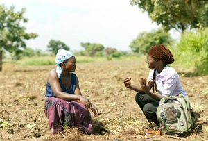 """A junior business advisor for TechnoServe discusses farming techniques with a Ugandan farmer. Technoserve is the NGO receiving the most funds from the Gates Foundation. It'sa US based NGO that develops """"business solutions topoverty"""". Running on an $80 million annual budget, it received a total of$85 million from the Gates Foundation duringthe last decade. Over half of these funds came through a 2007grant """"to helpentrepreneurial men andwomen in poor rural areas of the developing world build business"""".Technoserve carries out this work through partnerships with food corporations such as Cargill, Unilever, Coca Colaand Nestlé, who bring """"world-classbusiness and industryexpertise"""" and who are offered, through the programme, """"new market and sourcing opportunities""""."""