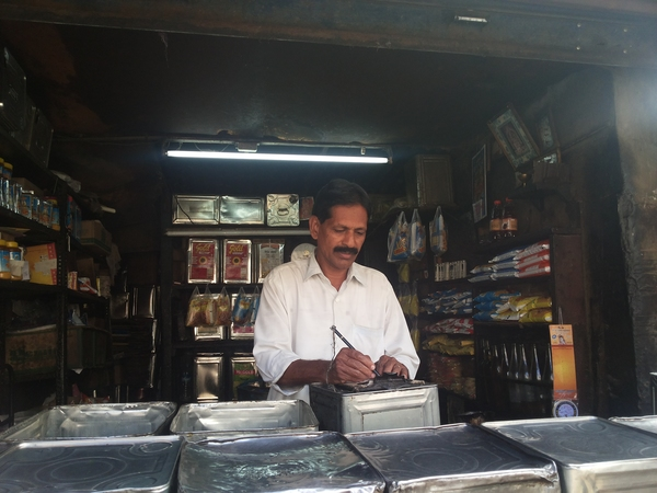Nirmal at his kiosk in Bazaar Street, Bangalore. (Photo: GRAIN)